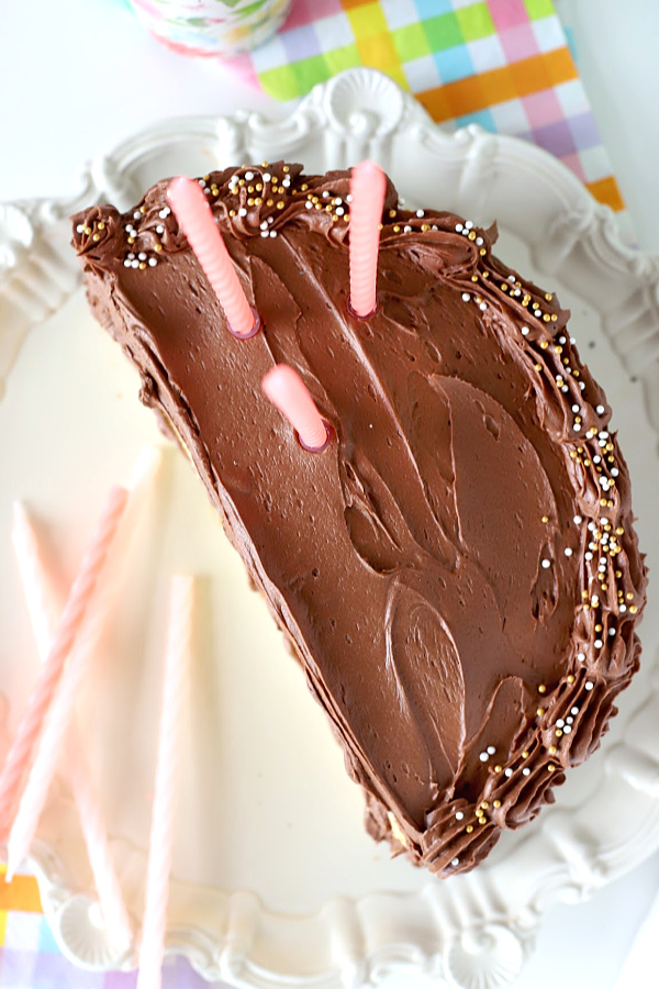 Easy recipe for the best fluffy chocolate frosting. Rich, dark and creamy, it is the perfect birthday cake and cupcake icing.