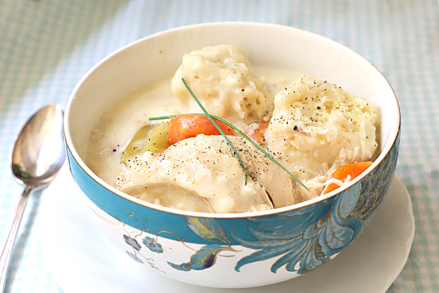 Bowl of tender chicken and dumplings.