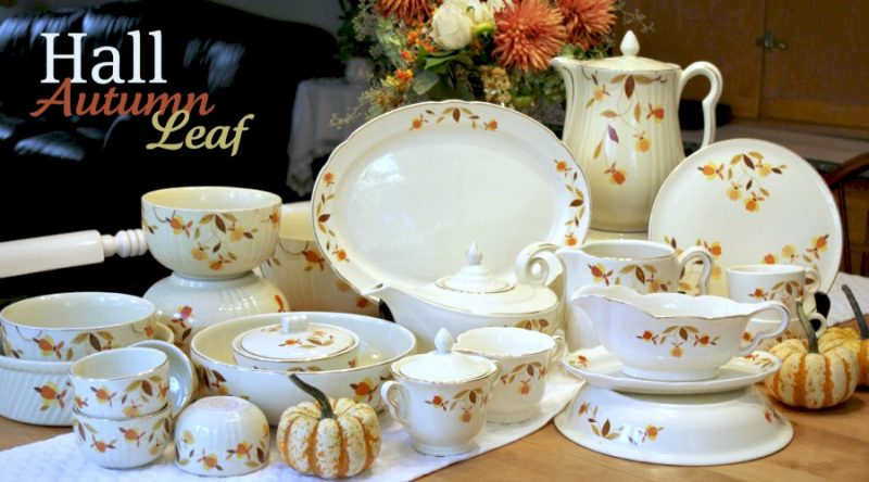 A collection of vintage Hall Autumn Leaf pottery pattern pieces with Jewel tea pot, mixing bowls, pitcher, coffee pot, platter and pie dish.