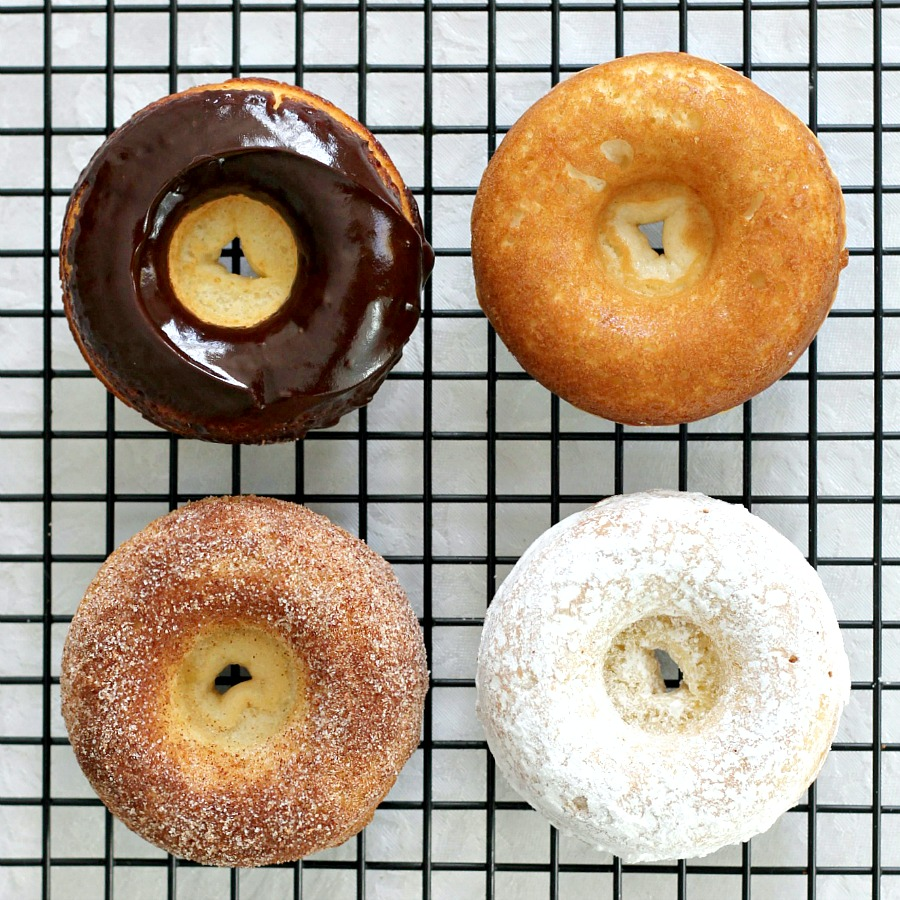 "Debate remains as to how to spell these circular wonders of dough with the hole in the center. Spell ""donut"" or ""doughnut"", there is no debate about enjoying homemade, baked donuts. The only decision is whether to choose frosted, rolled in cinnamon sugar, confectioners' sugar or a perfectly plain doughnut. Skip the frying with this easy baked version."