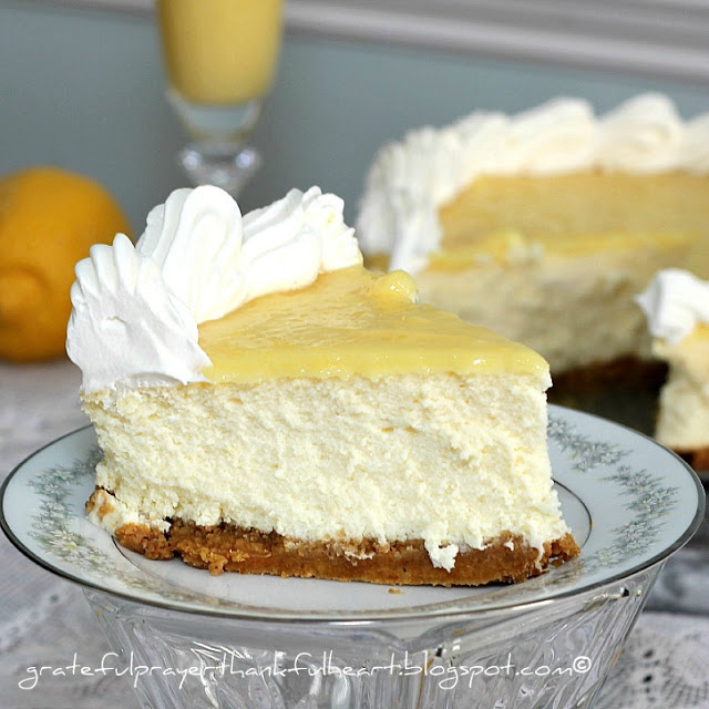 Creamy, delicious cheesecake made with lemon zest, juice and topped with lemon curd. A perfect balance of tart and sweetness on a graham cracker crust.