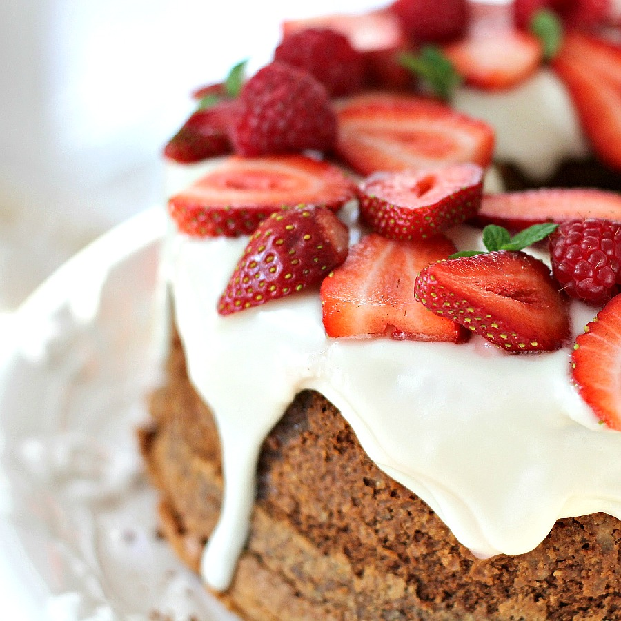 Cream Cheese Pound Cake is a showstopper dessert that is moist and delicious. Serve plain or dress it up with snowy white frosting and top with strawberries.