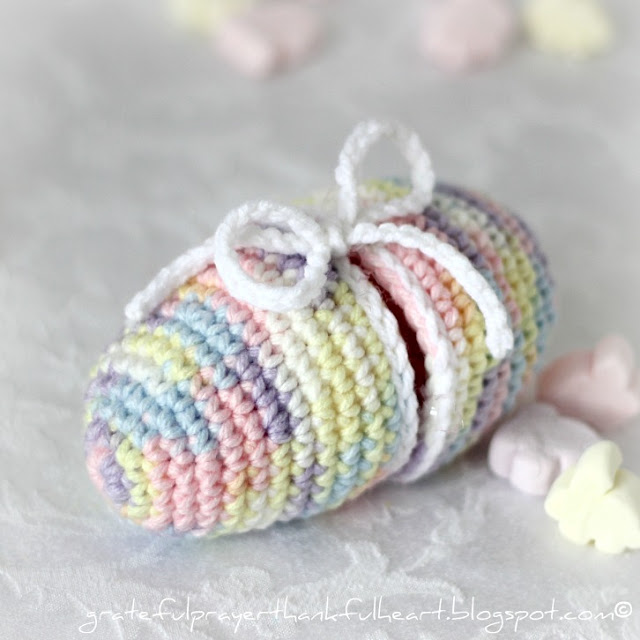 Easy pattern for Crochet Easter Egg that separates to open. Fill with a little Easter grass. tuck in candy or small toys and tie to close.
