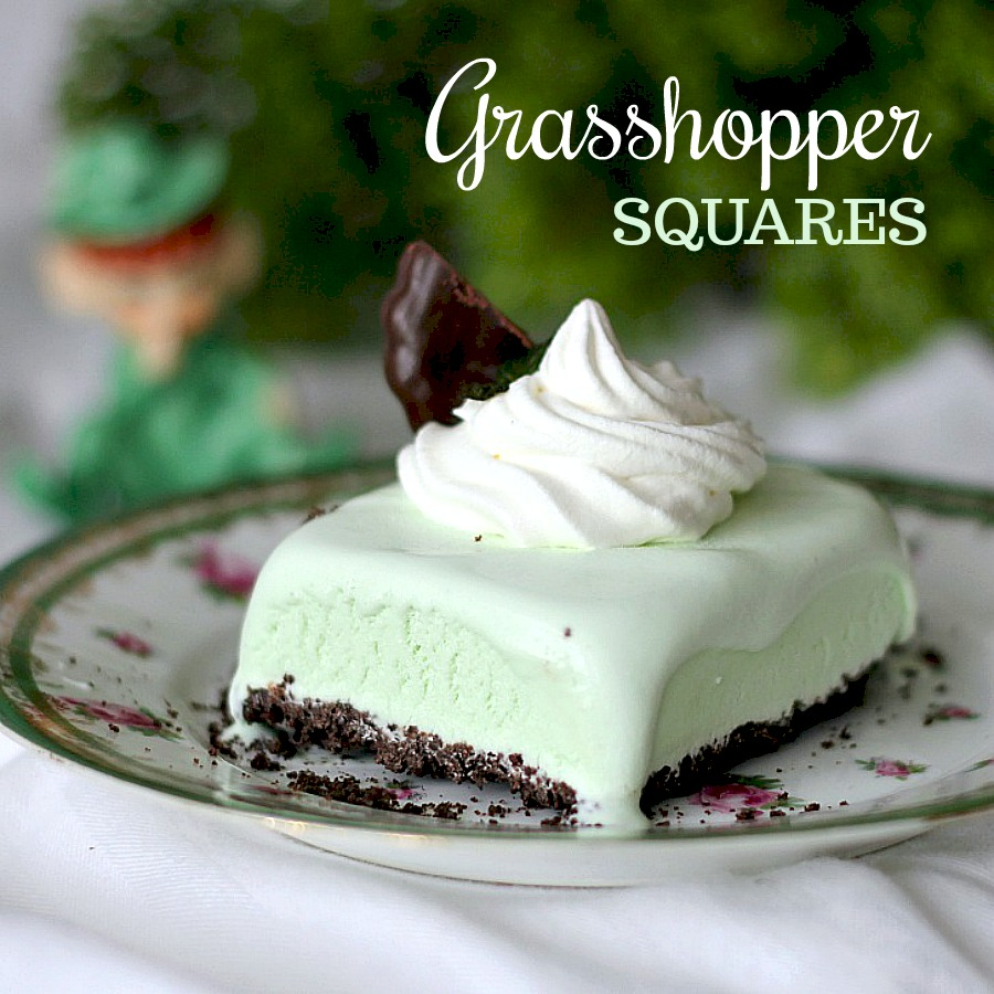 Frozen, minty Grasshopper Dessert Squares are the perfect St Patrick's day treat or any time you want an easy, no-bake dessert. Crust is made using fudge mint cookies and then filed with ice cream and topped with a dollop of whipped cream. Make ahead and freeze and it is ready whenever you want.