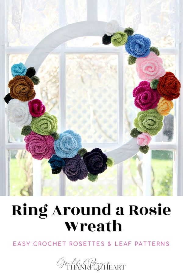 Bright and cheerful wreath made with crochet rosettes and leaves from very easy patterns. Great stash buster way to use leftover yarn from finished projects.