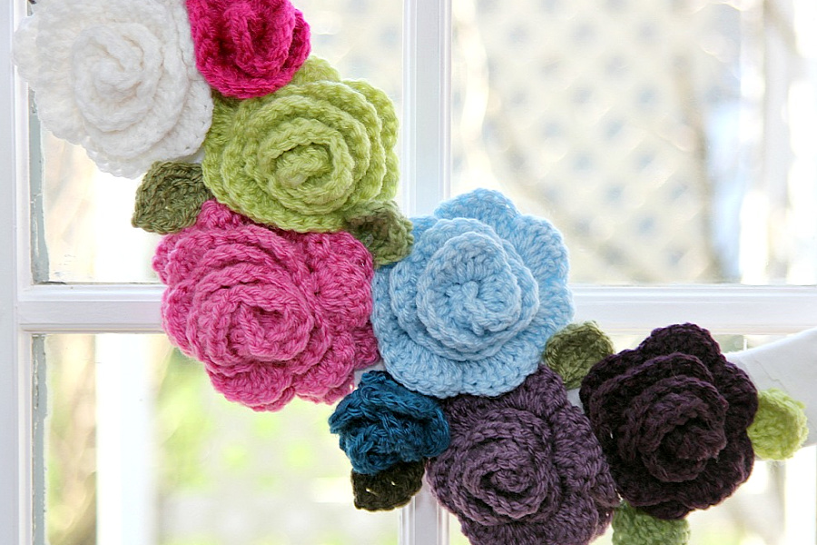 Beautiful, colorful rosettes for crafts and decorating projects. Easy step-by-step how-to pattern for making crochet leaves and roses.