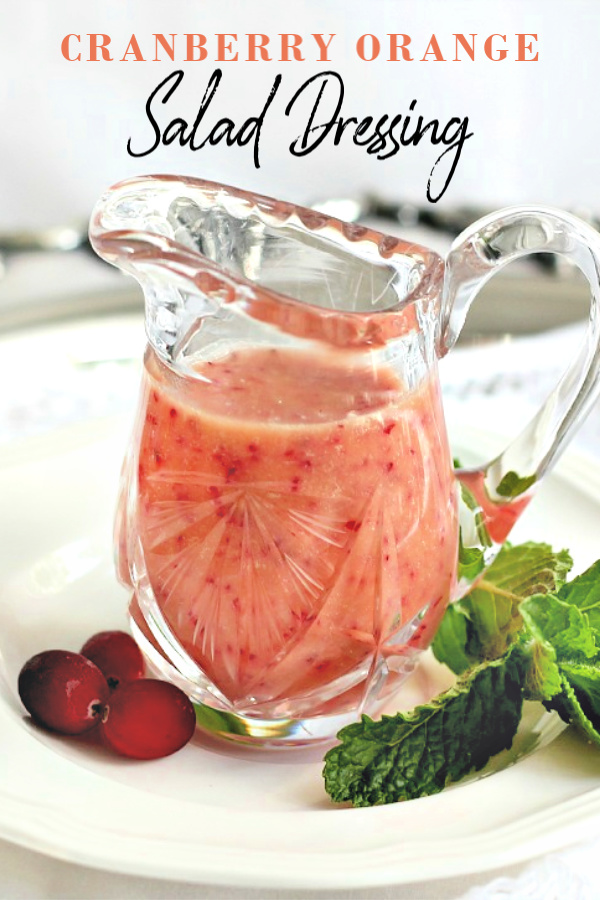 Cranberry orange salad dressing adds a bright citrus taste with little flecks of cranberry throughout a creamy vinaigrette.