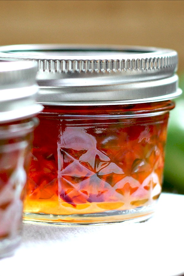 Homemade pepper jam is an easy recipe for a lovely colored, condiment or food gift. Perfect balance of sweet and heat used as an appetizer with cheese and crackers.