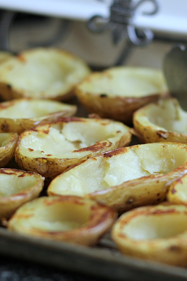 Oven crisped Potato skins make an easy and delicious appetizer. Baked until crisp and loaded with bacon, cheese, green onions or sour cream.