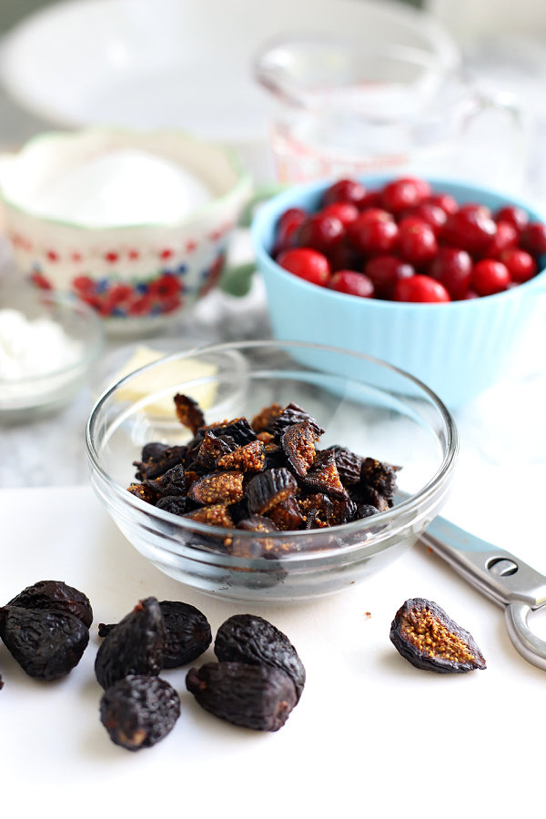 cutting dried figs for cranberry and fig pie