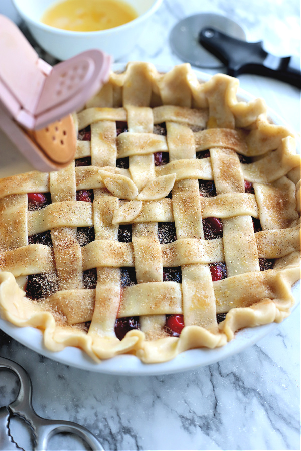cinnamon sugar on cranberry and fig pie lattice crust