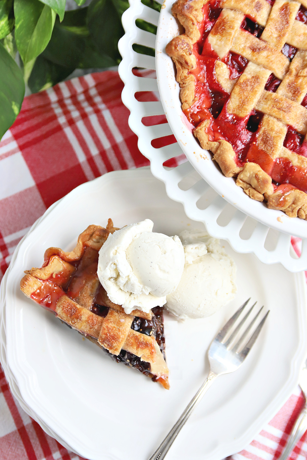 A slice of cranberry and fig pie with the perfect balance of sweet and tart flavors. Easy recipe for this old-fashioned dessert with how-to instructions for making the pretty lattice top crust.