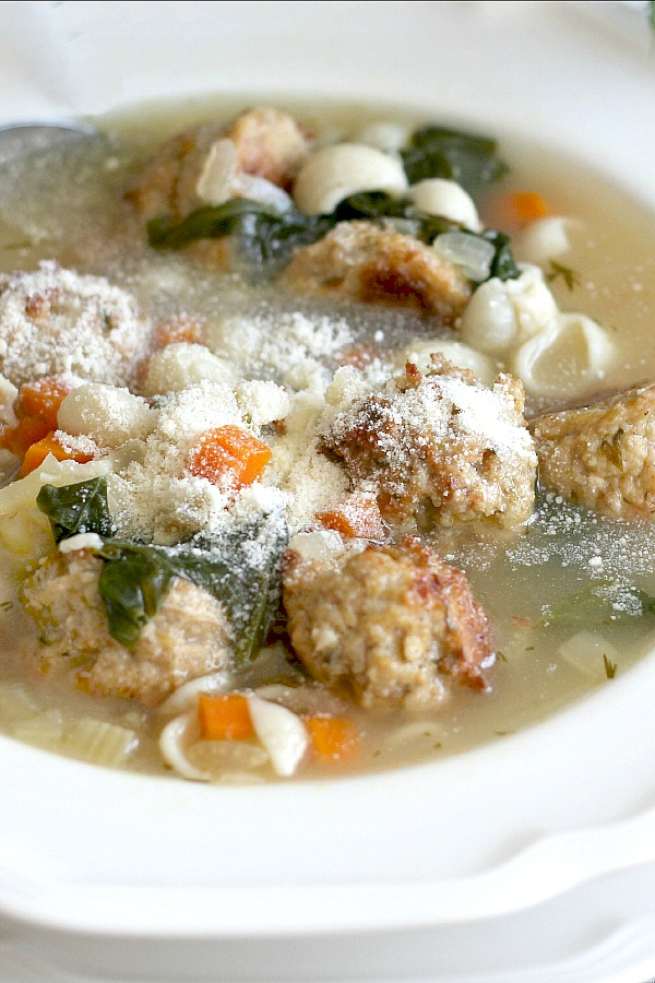 Tender meatballs made with ground chicken and sausage with pasta and vegetables in this easy recipe for classic Italian Wedding Soup. A delicious soup!