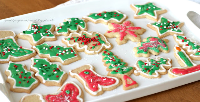 Frosted Sugar Cookies are festive and fun for holidays or birthdays. Easy recipe for cookies and frosting to make the prettiest and tastiest cookies!