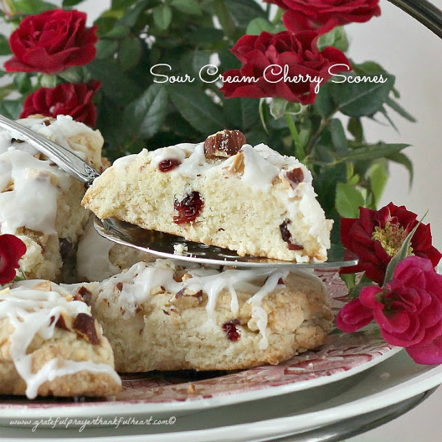 asy Sour Cream Cherry Scones arenot-too-sweet, filled withdriedcherries, sprinkled with chopped almonds then drizzled with a confectioner's glaze.
