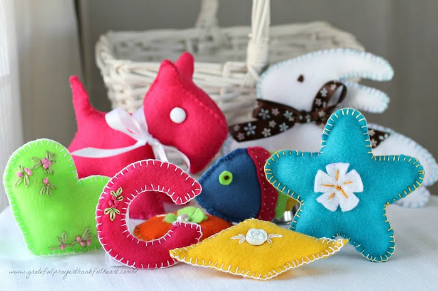 Sweet basket of felt toys for baby's birthday are perfect for little hands. Soft and colorful, in easy-to-make pattern shapes with pretty stitching.