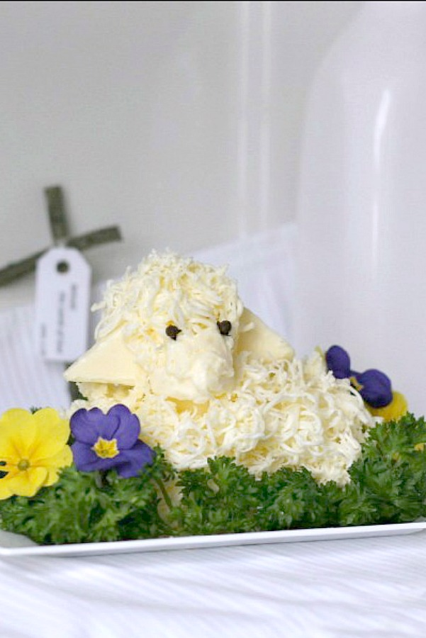 Easy directions to create this sweet little Easter butter lamb, covered in woolly curls. These sweet butter sculptures traditionally accompany the Easter meal for many Russian, Slovenian and Polish families. Butter is shaped into a lamb and is cute, decorative and symbolic for your holiday table.