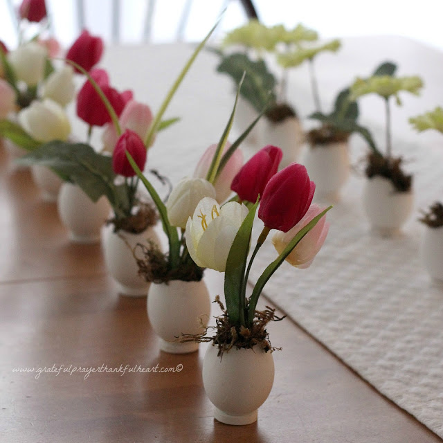 Sweet and dainty, springtime Easter flowers in eggshell pots are super cute. Fill with faux flowers, fresh cut flowers or plant seeds and watch them sprout. Tuck into spaces needing some happy after a dreary winterscape.