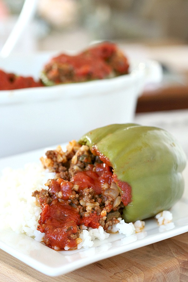 Sweet bell peppers filled with ground beef and rice and topped with your favorite sauce is a great dinner favorite.