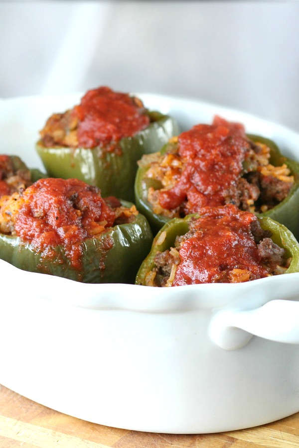 Classic stuffed peppers are an easy and comforting meal of tender bell peppers filled with ground beef and rice, baked and topped with your favorite sauce.