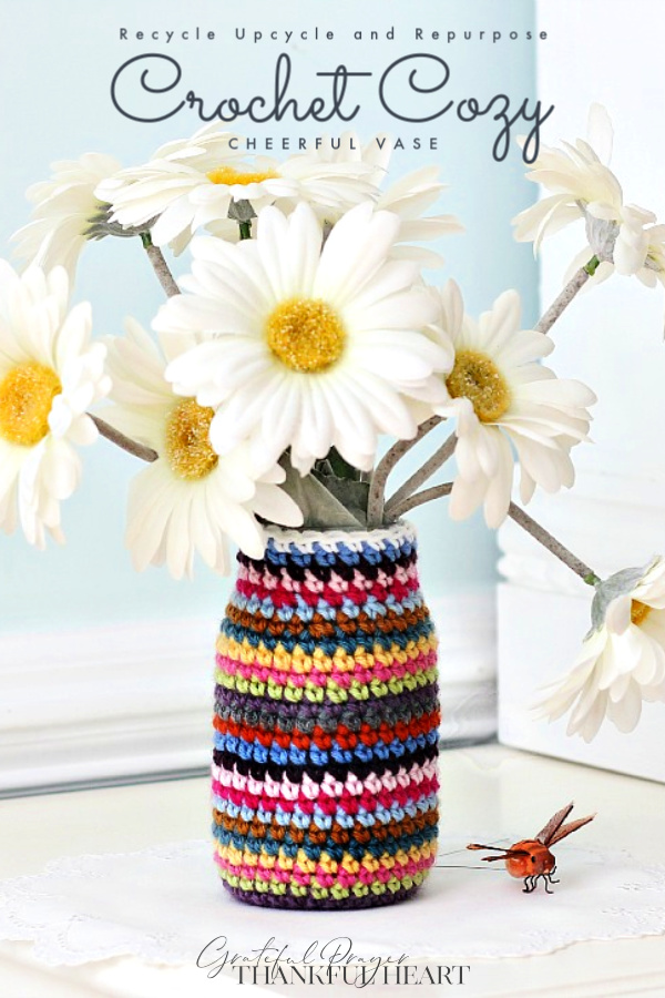 Don't toss those jars and cans! Reuse, recycle and repurpose into useful items. Easy how-to pattern to crochet a sweet cozy to make a flower vase or container for multipurposes.