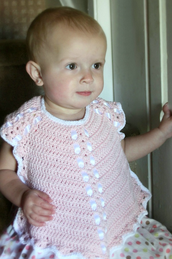 Sweet crochet baby bib is adapted from a vintage pattern and perfect for a toddler. Almost too pretty to use as a bib but adorable to dress up an outfit.