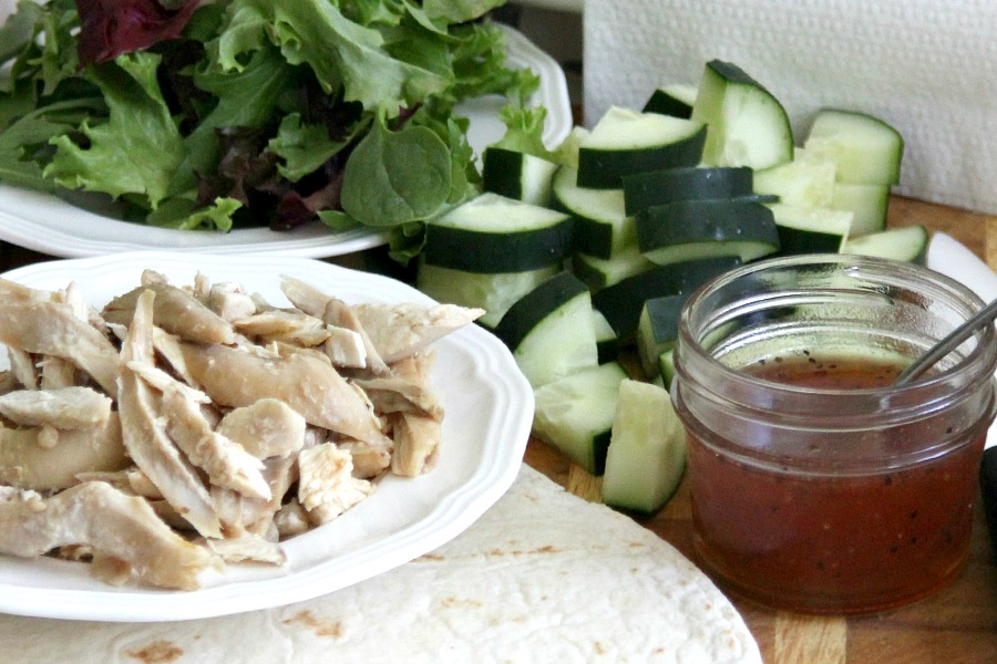 Easy, delicious & healthy lunchtime or lighter evening meal. Chicken Wrap with crisp cucumber, chicken, spring greens rolled up in a tortillas & drizzled with sweetened chili sauce is a perfect choice.