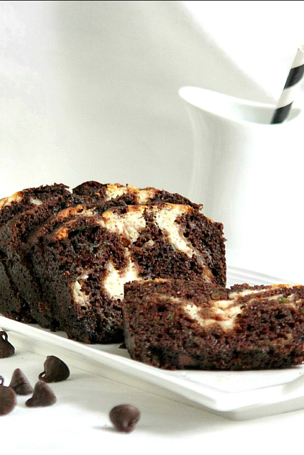 Cream Cheese Swirled Double Chocolate Zucchini Bread - that is a lot of words for a recipe title!  But it fits for this concoction I came up with for a rich and chocolaty bread that has three cups of zucchini!