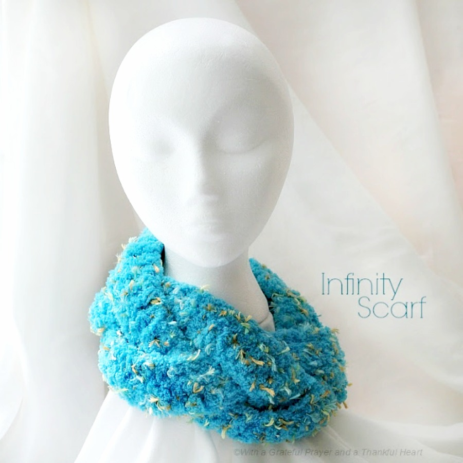 Easy crochet pattern for short version infinity scarf. Works up quickly and pattern is easily adapted. Pretty aqua yarn.