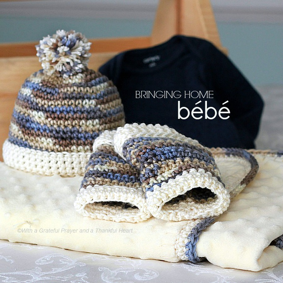 Crochet edge baby blanket with a sweet border around a fleece fabric with matching infant beanie and tiny leg warmers makes a lovely baby shower gift.