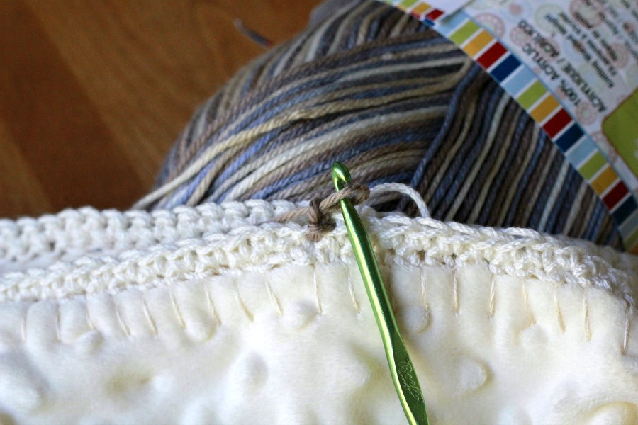 Crochet edge baby blanket with a sweet border around a fleece fabric creating a cozy, snuggly lovey. Perfect baby shower gift or as a sofa throw.