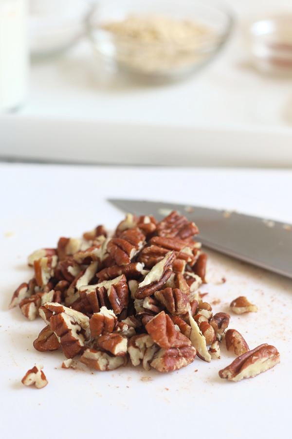 chopping pecans to make apple coffee cake recipe