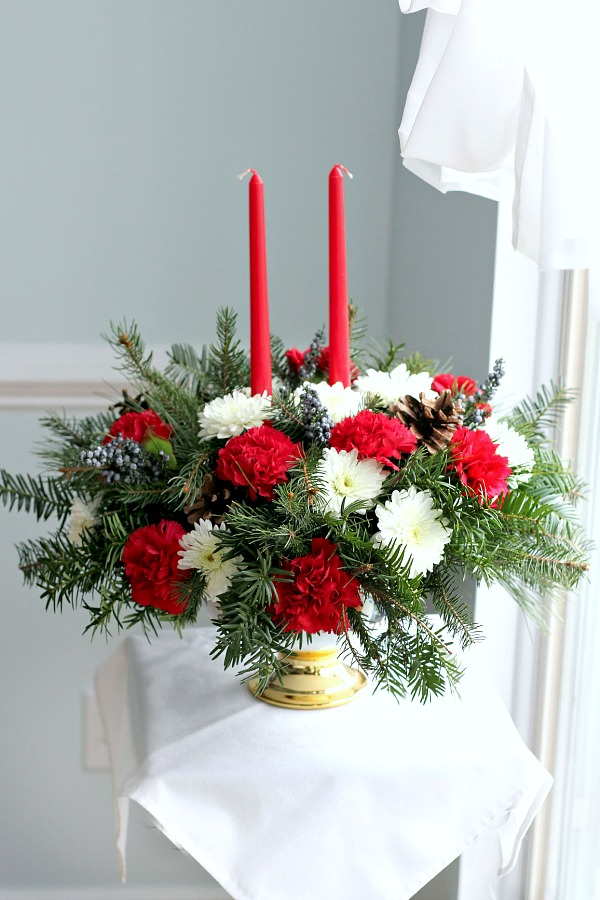 Easy DIY to make an inexpensive floral Christmas centerpiece using greens from your yard and flowers from the produce store or grocery store. Brighten your home for the holidays with flowers!