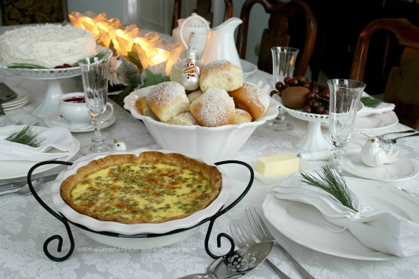 Brighten those winter blues with a lovely Winter's White lunch with friends. Tablescape, menu for snowflake rolls, quiche, white cake with coconut frosting.