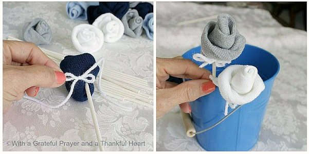 Lift the cuff and flatten the sockBeginning at the toe edge, softly roll to the top of the sock. The roll doesn't need to be tight.