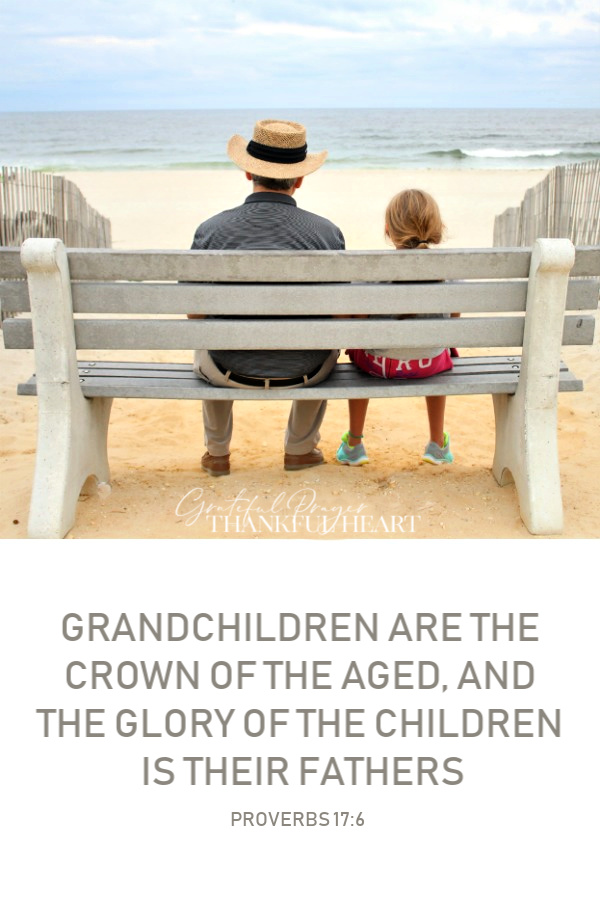 A girl and her grandfather on a bench at the beach enjoying the ocean view. Memories, relationship and love between the generations.