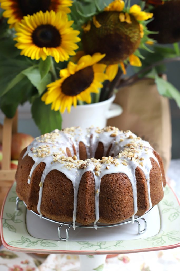 Need a quick and easy dessert? You'll love frosted apple walnut Bundt cake with grated apples, cinnamon, nutmeg, cloves, and walnuts or pecans.