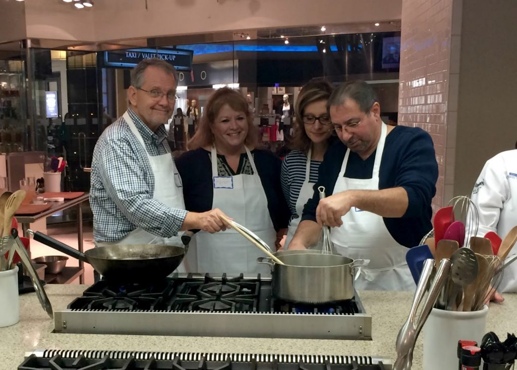 Celebrating anniversaries together is lots of fun. These two couples took a cooking class together and not only learned something new but had a blast.