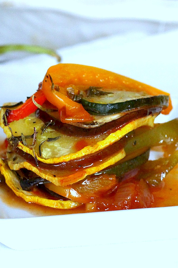 Kid-friendly ratatouille is a healthy combo of summer veggies. Easy recipe of sliced eggplant, zucchini, bell pepper and fresh herbs arranged over tomato sauce and baked until tender.