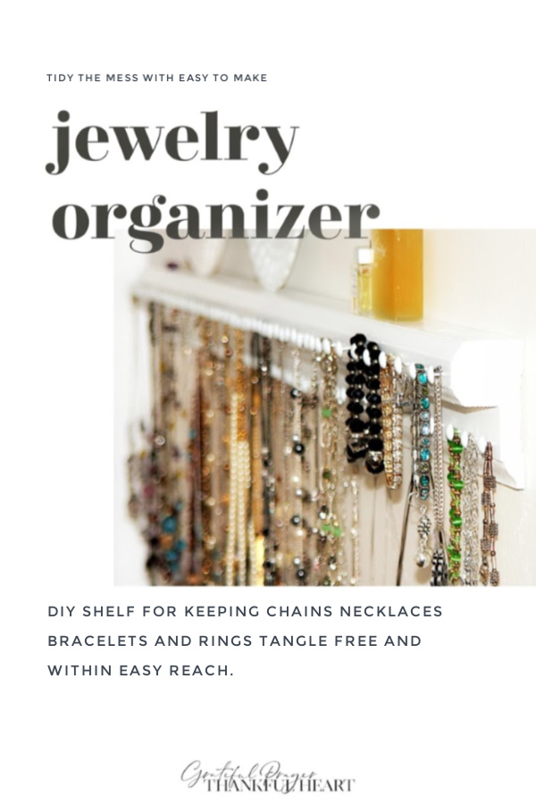Perfect solution for tangled necklaces and bracelets. Easy DIY wooden wall shelf has lots of hooks to keep jewelry neat and within easy reach.
