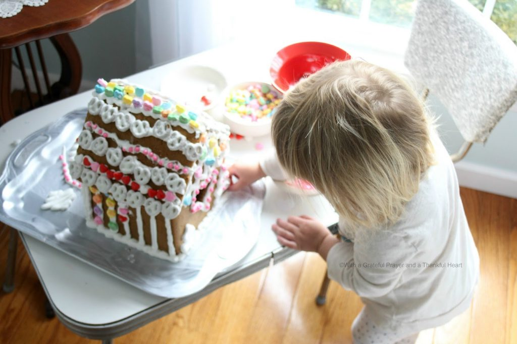 Super sweet, to make, Valentine's Day Gingerbread House. Decorate with Royal Icing as the glue for favorite candy and treats. Great kids project.