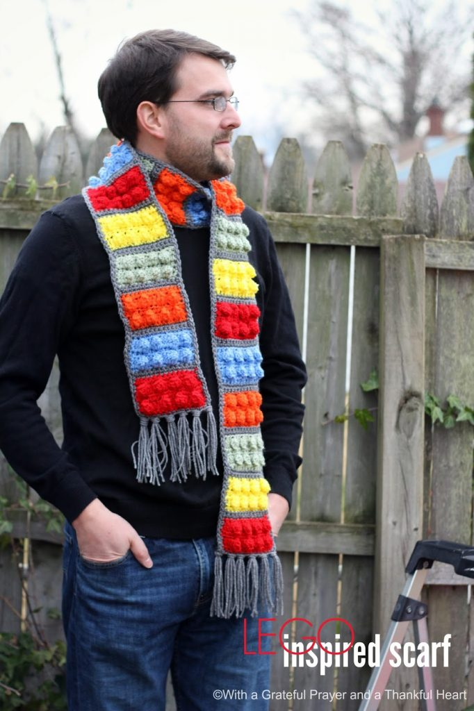 Easy pattern for a Crochet Lego Blocks Scarf for the hipster or kid on your gift-giving list. Colorful popcorn stitch creates Lego looking blocks.
