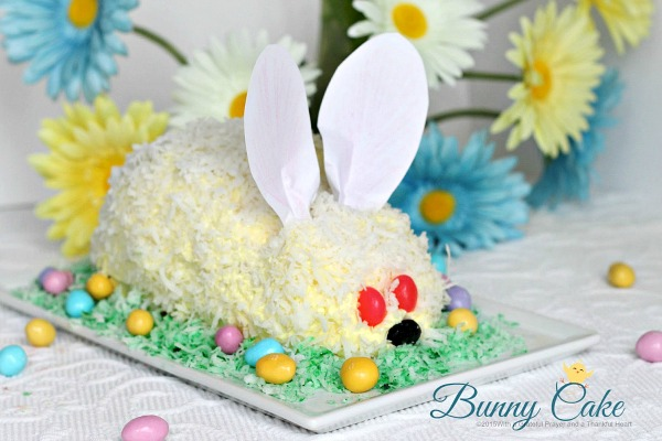 This adorable Easter bunny cake is made using a box cake and frosting (either homemade or from a tub). Our girls had the best time assembling it and were overjoyed with their finished creation. Truly a fun project and a lovely Easter dessert. It looks super cute on the holiday table.