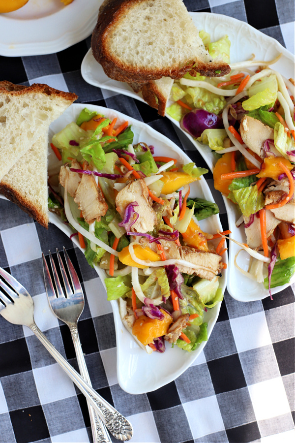 Chicken pineapple mango salad with romaine, carrots, bean sprouts, and chow mein noodles in a flavorful and refreshing dressing.