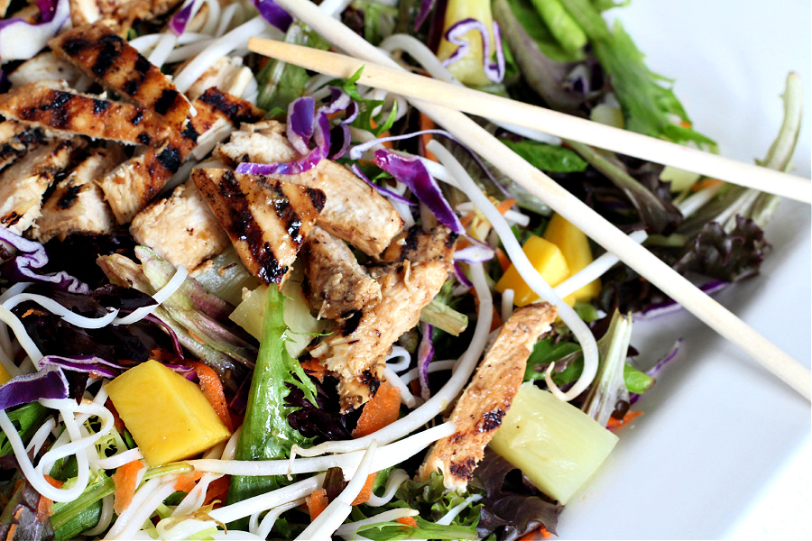 Chicken pineapple mango Asian salad with romaine, carrots, bean sprouts, and chow mein noodles in a flavorful and refreshing dressing.