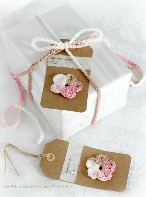 Embellish gift packages with quick and easy crochet gift tags, ties & bows. Reusable and so cute. Add tiny flowers, hearts, leaves and wreaths of yarn.
