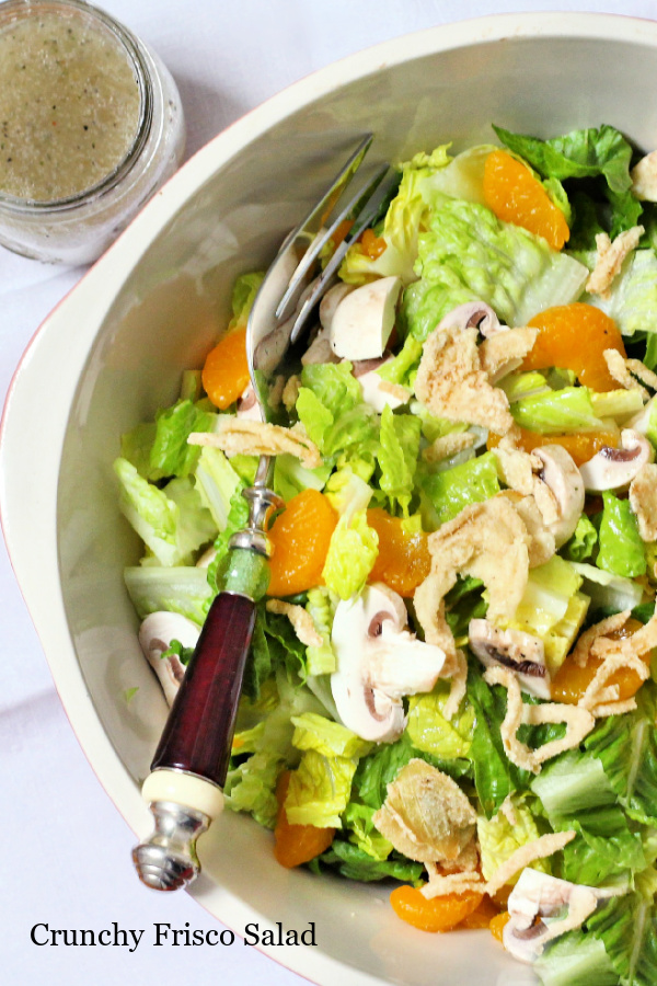 1980's retro recipe, Crunchy Frisco Salad is an easy recipe using just 5-ingredients. Mandarin oranges, mushrooms greens, fried onions and Italian dressing.