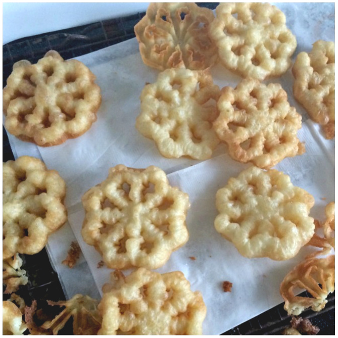 How-to recipe for Scandinavian Rosettes. These thin, cookie-like pastry treats are deep-fried until light and crispy. An easy recipe perfect on your holiday cookie tray or any time.