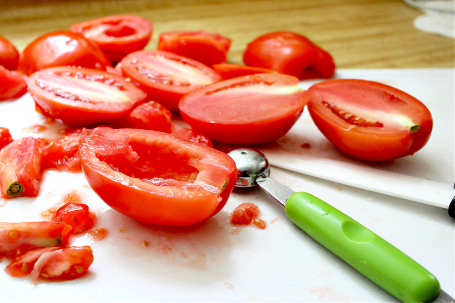 Preparing Roma tomatoes for roasted tomato Capresse salad