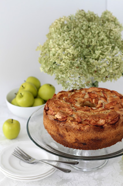 Incredibly delicious and moist Jewish Apple Cake from Mom's vintage recipe. Baked in a bundt pan and filled with the wonderful autumn flavors of apple and cinnamon.